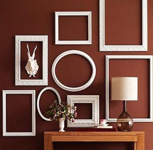 Дизайн оформления стены рамками