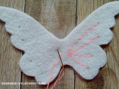 вышивка узора на крыльях